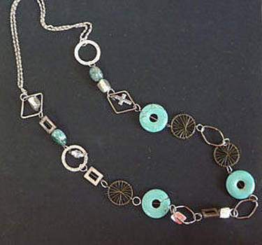 Turquoise Doughnuts W. Silver Rings by Joan  Jones