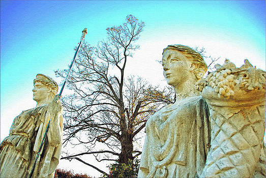 Two statues by Janet G T