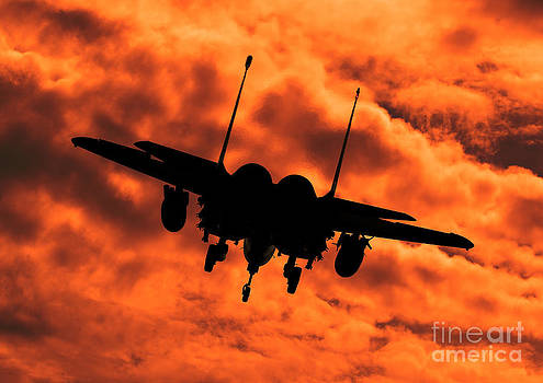 USAF Strike Eagle F15 E flying into the Sunset by Clare Scott