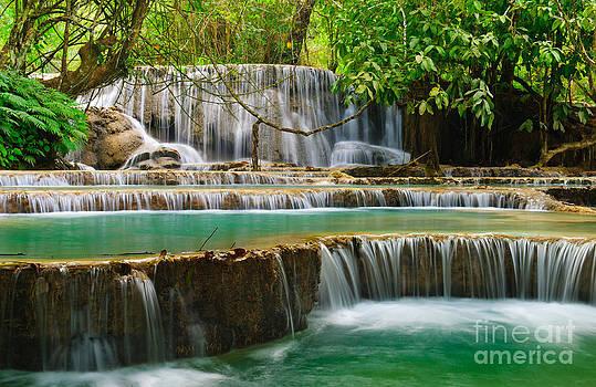 Waterfall in lunagprabang Laos by Noppakun Wiropart