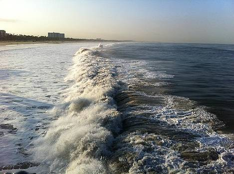 Waves breaking at the pier by Rebecca Hale