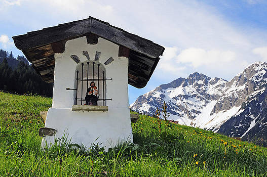 Wayside Shrine in the mountains by Matthias Hauser