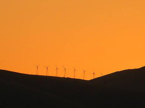 Windmills 22 orange sky at night by Maggie Cruser