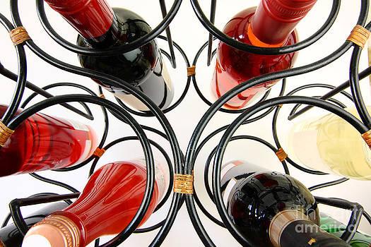 Simon Bratt Photography LRPS - Wine bottles in curved wine rack
