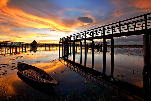 Wood Bridge in sunset thailand by Arthit Somsakul