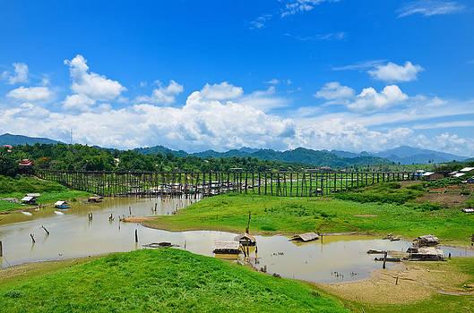wooden bridge in Sangkhlaburi by Kanoksak Detboon