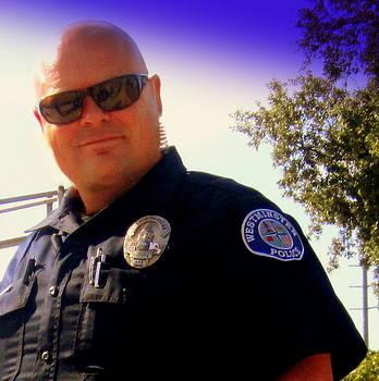 WPD Officer Couvalt by Nancy  Wood