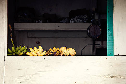 Yellow bananas on a ledge in the Caribbean by Anya Brewley schultheiss