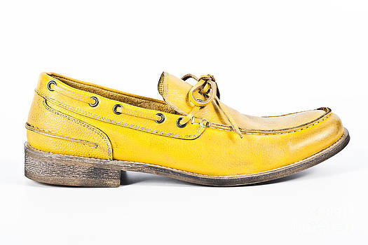 yellow Mens shoe by Chavalit Kamolthamanon