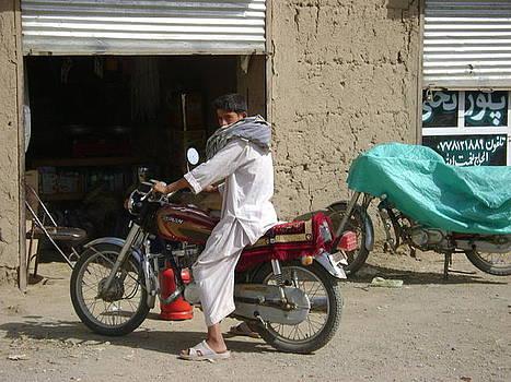Afghan on motorbike by Ian Dudzinski