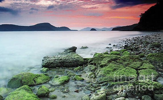 Beautiful rocky coastal sunset  by Anusorn Phuengprasert nachol