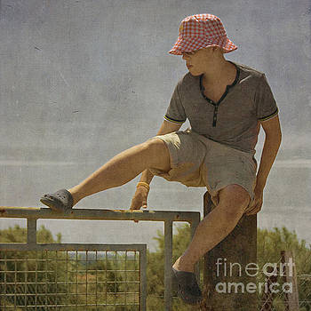 Boy on a fence waiting for Lance Armstrong by Paul Grand