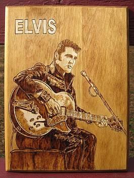 Elvis playing guitar by Bob Renaud
