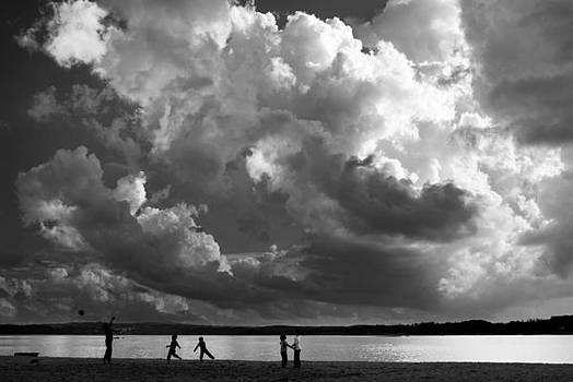 Kids Playing at the Beach by Dias Dos Reis