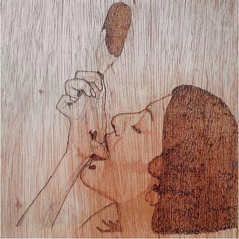 Licking by Ashraf Mohammed Musaliyarkalathil