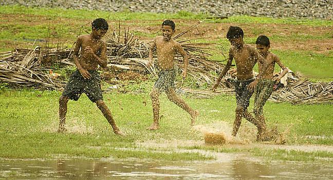 Monsoon Football - 1 by Sydney Alvares