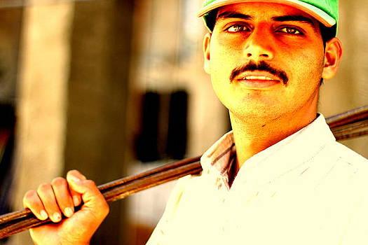 Pakistani worker  by Dareen  Hasan