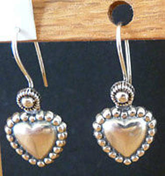 Sterling hearts and wires by Joan  Jones