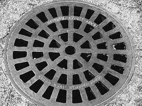 Emily Kelley -  Black and White Manhole Cover