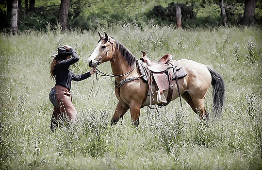 A Cowgirl And Horse by Athena Mckinzie