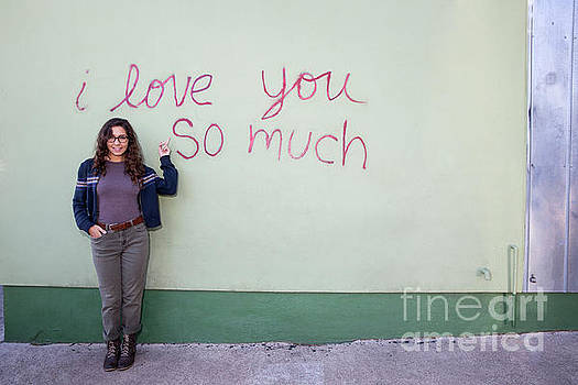 Herronstock Prints - A local Austinite points to the iconic I Love You So Much Mural