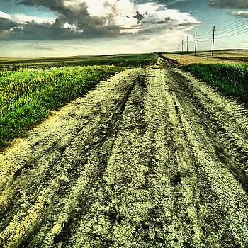 A long gravel road by Jeff Swan