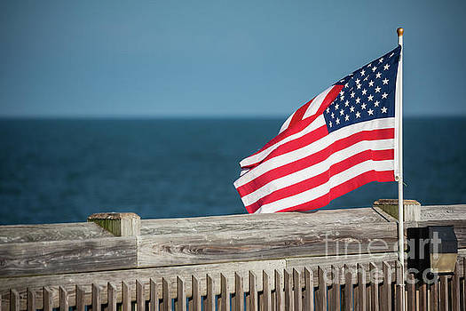 American Flag on South Carolina Pier by Leslie Banks