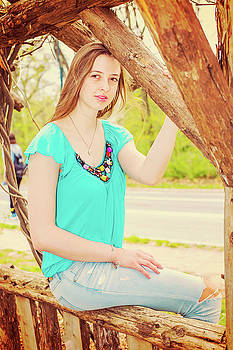 Alexander Image - American Teenage Girl relaxing at Central Park in New York in sp