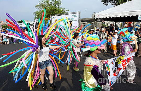 Balloon Artists Join A Street Parade by Yali Shi