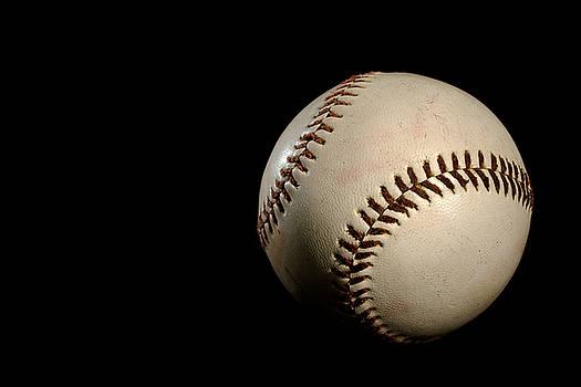 Baseball ball by Felix M Cobos