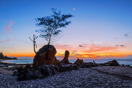 Beautiful rocky Tindakon beach sunset view in Kudat Malaysia by Pradeep Raja PRINTS