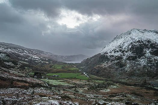 Beautiful Winter landscape image in Llyn Gwynant in Snowdonia Na by Matthew Gibson