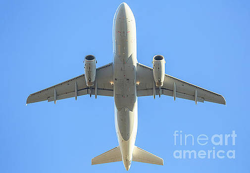 Behind White Airplane In The Sky by Benny Marty