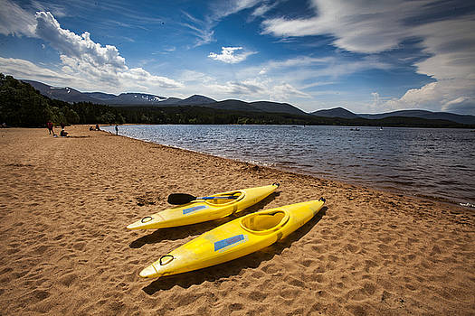 Canoes on the beach at Loch Morlich by Michael Schofield