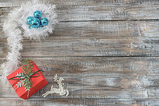 Christmas decorations on a wooden background, top view with cop by Julian Popov