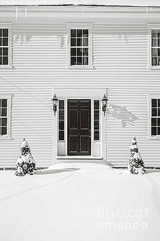 Classic New England Wood Framed Colonial Home in winter by Edward Fielding