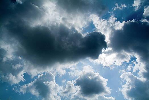 Sami Sarkis - Clouds floating across a blue sky