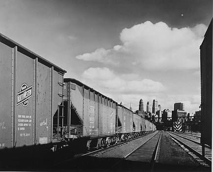 Chicago and North Western Historical Society - Coal Hoppers With Chicago Skyline on Horizon