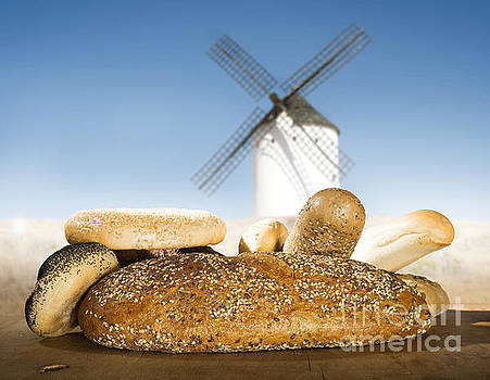 Different breads and windmill in the background by Deyan Georgiev