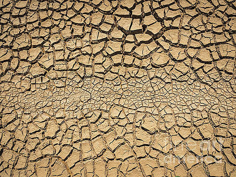 Dried And Cracked Soil In Arid Season. by Tosporn Preede