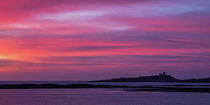 Dunstanburgh Castle Sunrise by David Pringle