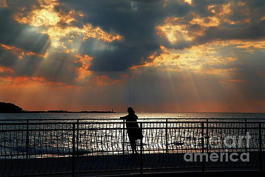 Female Silhouette Sunset by Aleksey Tugolukov