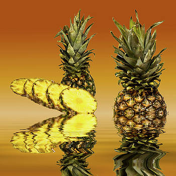 Fresh ripe pineapple fruits by David French