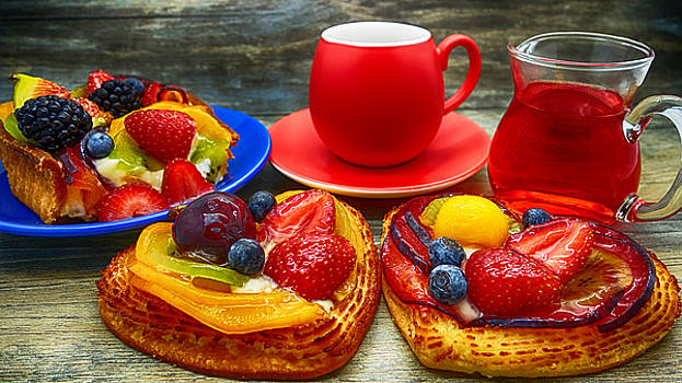 Fruit desserts and cup of coffee by Nika Lerman