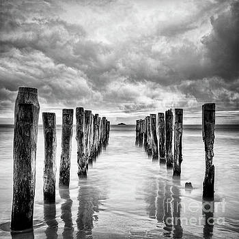 Gathering Storm Clouds Over Old Jetty by Colin and Linda McKie