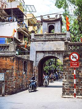 Hanoi, Vietnam  Hanoi city street view with people by Eduardo Huelin