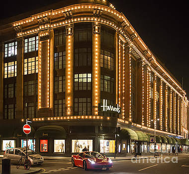 Harrods department store. Facade illuminated at night.  by Deyan Georgiev