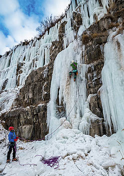 Ice climber works his way up a route on Lama Wall in Idaho by Elijah Weber