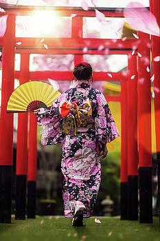 Japan lady in kimono walk in the temple by Anek Suwannaphoom