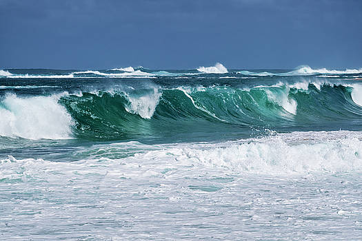 Large winter waves build and curl along Secret Beach. by Larry Geddis
